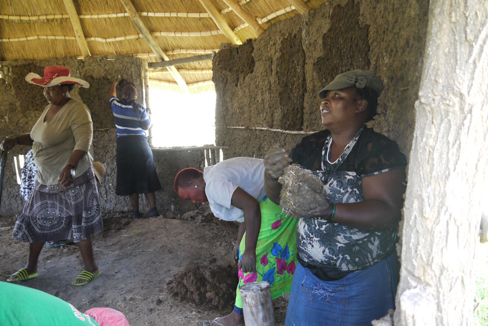 Women building in Naledi Village